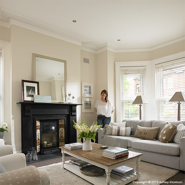 Ciara Nelson in the sitting room of her three storey semi-detached villa in Belfast.