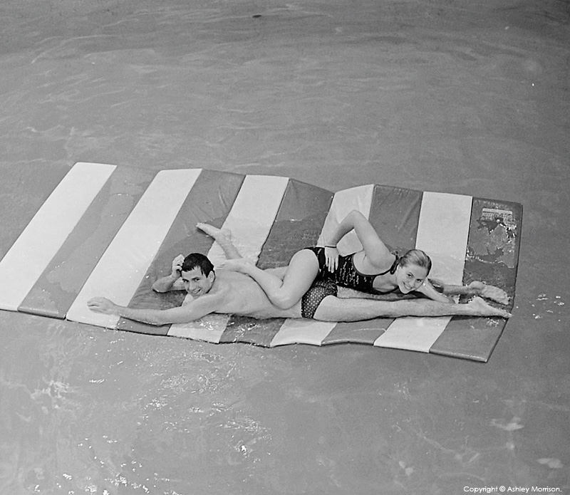 Christina Anderson (Christina Ica Hörbäck) and Andrew Gray playing on one of the mats in the diving pool at the Universtiy of Houston.