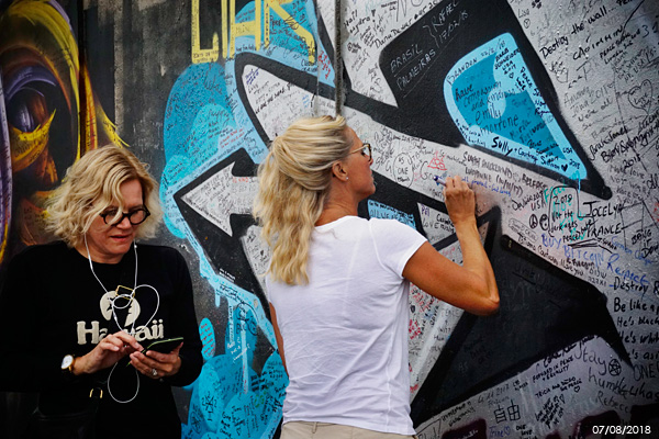Christina Ica Hörbäck with her sister, Annis Andersson Josefson, at the 'Peace Wall' .